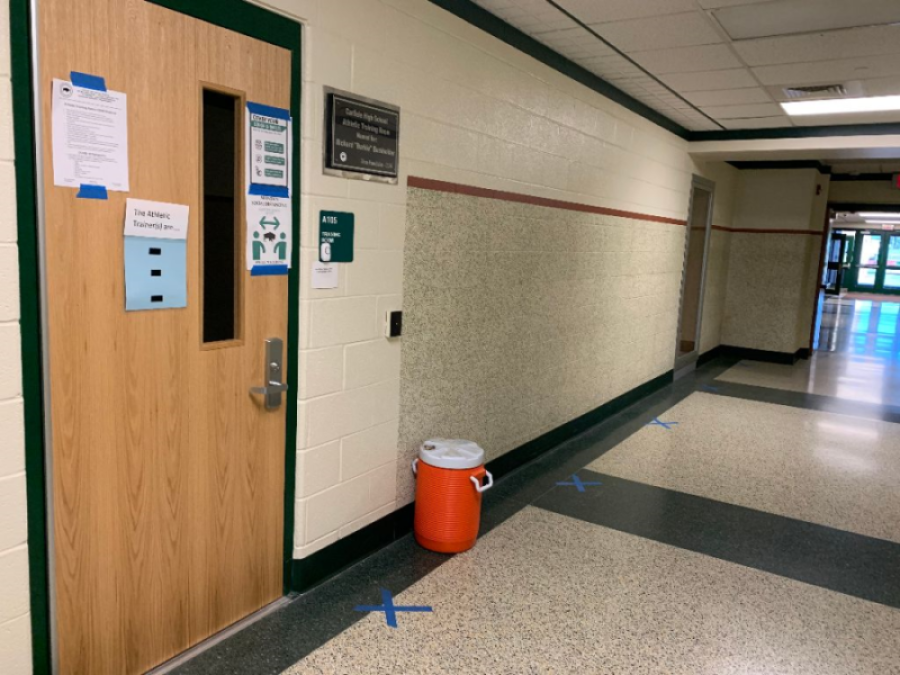 SAFETY FIRST: The athletic training room uses blue tape to mark social distancing for students in need of their help. This year, extra safety precautions are being taken in sports which not only affects games/meets and spectators, but also how athletic training is approached.