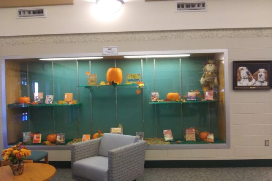 FEELING FESTIVE: In efforts to get in the fall spirit, the school library has set up their annual display. This display is filled with beautiful pumpkins, colorful leaves, and a variety of books that fit the theme of what happens during the fall season.