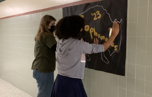 AMBITION WITH A MISSION: Both Ruby Frazier (left) and Maya Reichenbach belong to the Sophomore Class Council, for the class of 2023, and are setting up for Homecoming Week. As the hallways are lined with banners and school pride, Frazier, Reichenbach, and many of their peers are hard at work ensuring there is school pride to admire around every corner.