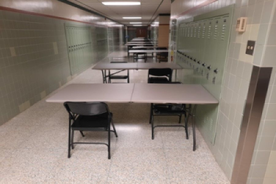 HAVE A SEAT: Tables are set up in the hallways for lunch. This year, students will have to socially distance during lunch, making it harder to socialize, but not impossible.