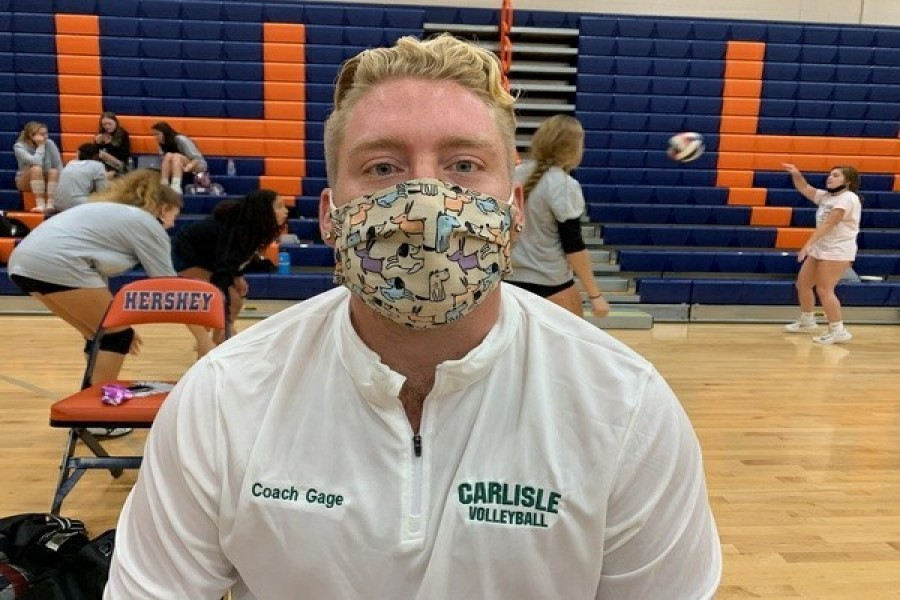 Girls volleyball coach Gage Boisvert shows off his love of dogs with his mask at practice.