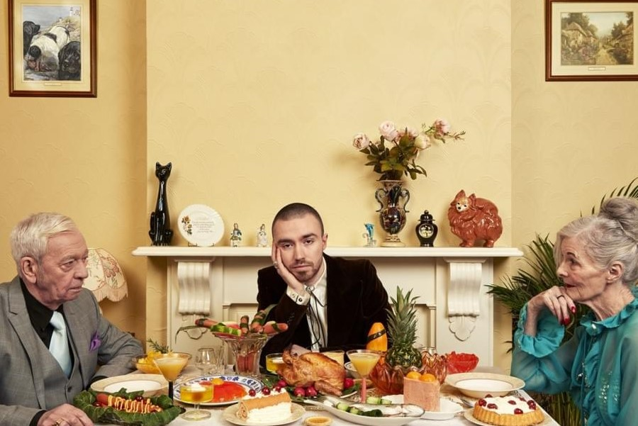 ONE BIG PLATE: The album cover for Bad Contestant shows Maltese looking very bored as he sits between a fighting older couple.