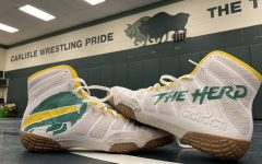 Carlisle High School inspired custom wrestling shoes sit in the middle of the wrestling room. After the Thundering Herds long practice spent preparing for the 2021 season. The Herd look to improve upon their 8-7 season a year ago.