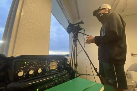 NEW PERSPECTIVES: Carlisle High School junior Austin Shatto adjusts his camera angles in preparation for a Herd TV livestream during the 2020 Football season. Herd TV has also live-streamed Basketball this year and looks to broaden the sports being streamed in the future.