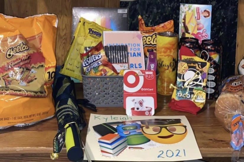 BASKET+OF+ABUNDANCE%3A+CHS+senior+Kyleigh+Zenewicz+shared+this+snapshot+of+the+gift+basket+she+received+from+her+sponsor.+Community+members+look+to+fill+the+baskets+with+the+senior%27s+personal+favorites%2C+in+hopes+of+a+lasting+memory.