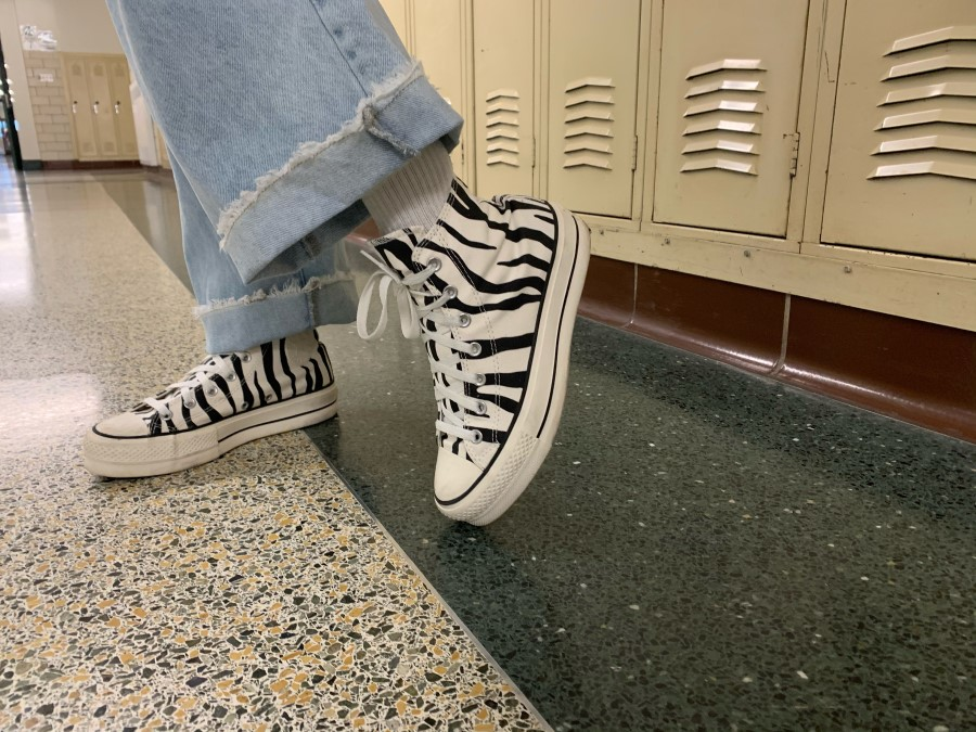 Alyssa Dyson shows off her favorite Christmas gift, platform converse. Platform shoes have come back into trend, giving those who wear them a couple inches to add to their height. A little bit of a platform adds spice to any regular shoe.